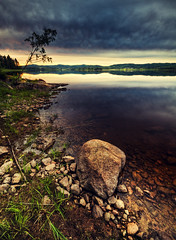 Dark water (- David Olsson -) Tags: sunset lake nature water grass reflections landscape nikon rocks cloudy sweden stones tripod sigma 1020mm polarizer hdr vrmland leaningtree lakescape photomatix sunne lonesometree d5000 vstramtervik aplungen davidolsson polarizingfiltercpl