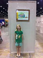 R and her yellow ribbon painting! (The Egg, Man) Tags: carnival summer kids fun ky funhouse rides midway 2011 kentuckystatefair