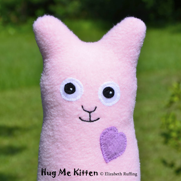 Pink fleece Hug Me Kitten by Elizabeth Ruffing