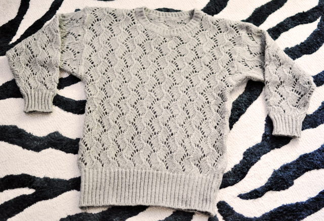 sweater on zebra rug