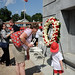 A youngster dons a toy firefighter's helmet while paying his respects at the Belltower.