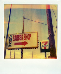 Barber Shop & 7/Eleven (Nick Leonard) Tags: city vegas blue red summer sky orange white signs film analog vintage polaroid sx70 outdoors lasvegas nevada nick lightbulbs scan retro gasstation barbershop lightleaks signage arrow poles 7eleven servicestation polaroidsx70 polaroidlandcamera instantfilm epson4490 firstflush colorshade integralfilm nickleonard polaroidsx70model2 charlestonblvd theimpossibleproject px680 px680ff