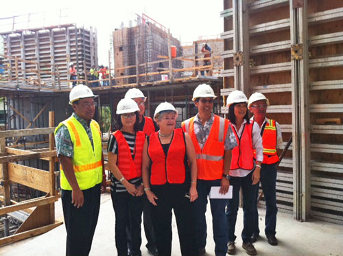 group in hardhats with Honolulu cityscape in background