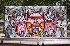 Outdoor Gallery... (Trapac) Tags: barcelona park city summer urban streetart art face wall bench graffiti spain eyes nikon colours faces decorative teeth graf tags catalonia espana catalunya graff benches emptybench nikkor3570mm poblesec d700 graffwall lacanadenca nikond700 threechimneyspark parkdelestresxemeneies