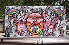 Outdoor Gallery... (Trapac) Tags: barcelona park city summer urban streetart art face wall bench graffiti spain eyes nikon colours faces decorative teeth graf tags catalonia espana catalunya graff benches emptybench nikkor3570mm poblesec d700 graffwall lacanadenca nikond700 threechimneyspark parkdelestresxemeneies