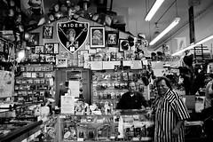 father and son (astro twilight) Tags: bw oakland football silverandblack knives fans raiders temescal helmets shavecut cmwdbw