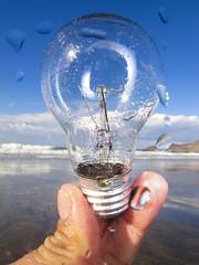 Beached lightbulb (Alex Bramwell) Tags: ocean old sea inspiration beach lightbulb bulb idea holding hand fingers beached conceptual washedup