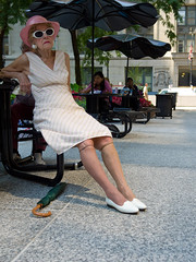 Lounging Lady (misterbuckwheattree) Tags: woman chicago stockings hat sunglasses umbrella sitting loop streetphotography lounging sundress picnictable elderlywoman daleyplaza chicagoist