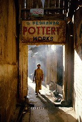 Peshawar, Pakistan, 1988 (Photox0906) Tags: door pakistan light shadow silhouette sign mystery alley asia darkness ditch lumire smoke ombre pot signage works pottery peshawar porte asie gutter ruelle bazaar 1001nights bazar channel rigole obscurit poterie enseigne jarre fume mystre potier atravsde flickrgoldaward flickraward flickrbronzeaward flickrsilveraward yourarthastouchedtheworld universalelite andromeda50 1001nightsmagiccity flickraward5 flickrawardgallery