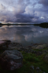 Who's that stone? (Alex.Lewis) Tags: sky lake reflection stone night clouds espoo finland landscape head a850 sonya850
