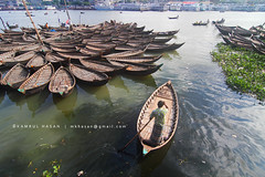 Duality of Buriganga (Kamrul - Hasan) Tags: flower water river living boat cityscape formation rivers orchestra environment dhaka bangladesh hazards polluted waterpollution riverscape gettyimagesbangladeshq3