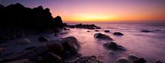 Sulinzara (Ghjattu) Tags: longexposure sunset sea panorama mer mare waves stones corse pano corsica panoramic canon5d sole vagues rochers leverdesoleil panoramique poselongue canon24tseii
