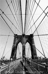 Brooklyn Bridge Part II (Matt Cousins Photography) Tags: new wood nyc newyorkcity bridge sky people blackandwhite usa white newyork black brick travelling tourism metal skyline brooklyn buildings person blackwhite unitedstates unitedstatesofamerica bridges tourist newyorker walkway brooklynbridge newyorkstate theunitedstatesofamerica newyorkers theusa newyorkbridge newyorkcitybridge travellingphotography travellingamerica mattcousins mattcousinsphotography