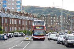 P1170991a - Lothian 657 approaches Eastfield on 08/09/11 (VV773) Tags: bus buses port edinburgh president dennis lb lrt seton lothian trident eastfield plaxton transbus x26 sn04aew