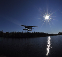 Pick Up! (Fish as art) Tags: canada nature flying aircraft north northern bushpilot yellowknife floatplane dehavillandbeaver outdoorphotography cessna185 nikonfisheyelens northerntravel paulvecseiimages