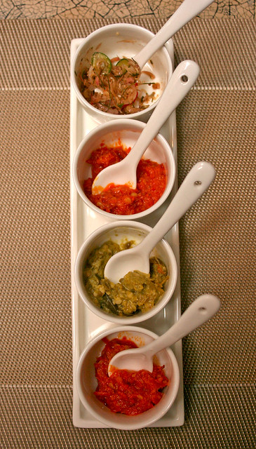 Several types of chillies and condiments are served