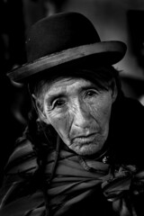 Beggar in Puno (Rob Kroenert) Tags: portrait bw white lake black peru titicaca southamerica monochrome hat america grandmother south beggar panhandler indigenous puno