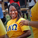 An Alpha Nu Omega sorority sister is all smiles at UAB Black Students Board Back to School Jam on Harris Field.