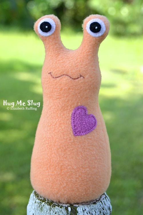 Soft light orange fleece Hug Me Slug by Elizabeth Ruffing