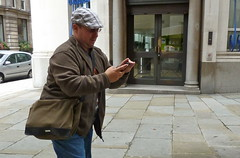 gordie in london! (estherase) Tags: gordon friend london camera phone findleastinteresting 0f emssimp cap hat friends