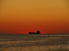 Black Sea: Ship and Man (Vlad Feoktistov) Tags: sunset shadow red sea orange man black yellow port golden surf ship little russia dusk surfing grade hour blacksea sochi