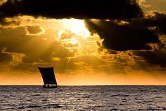 Vezo pirogue under the sun, par Franck Vervial (Franck Vervial) Tags: sunset sea cloud boat madagascar pirogue afrique malagasy flickraward flickraward5 flickrawardgallery