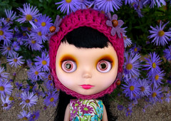 The girl with flowers in her hat