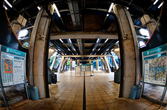 Underneath South Quay (Sean Batten) Tags: uk london architecture fisheye docklands pillars information dlr southquay