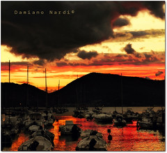 Lerici - Porticciolo al tramonto - (in eva vae) Tags: sunset red sea sky mountain seascape storm nature water yellow clouds boats bay pier dock nikon marine scenery italia waves purple framed liguria perspective barche porto elements squared lanscape paesaggio pontile laspezia lerici d90 scafi inevavae mygearandme ringexcellence flickrstruereflection1 damianonardi