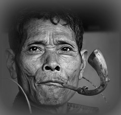 The pipe man (Linda DV (away)) Tags: travel portrait people blackandwhite bw india canon geotagged blackwhite pipe culture clothes portraiture squareformat tribe ethnic minority 2008 sevensisters tribo stam arunachal ethnology tribu stamm  trib trib 7sisters arunachalpradesh heimo northeastindia stamme daporijo pokolenia powershots5is minorit taliha  tagin minderheid  lindadevolder  plemena pokolen
