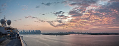 Approaching New York City - Fire in the Sky (CrapulePHL) Tags: new york city nyc cruise carnival red sky panorama water skyline brooklyn clouds sunrise canon river island fire boat twilight ship manhattan iso deck hudson 100 usm railing f56 efs 1022mm hdr 18s 22mm f3545 130s 1125s