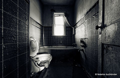She Came in Through the Bathroom Window (/ shadows and light) Tags: door loo texture abandoned window monochrome bathroom decay curtain toilet manitoba tiles knob derelict rag abandonment decayed washroom greentint ruralexploration rurex mcmunn