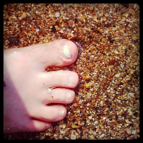 Toes in sand and surf