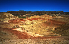 painted hills, oregon - or tatooine? (Xuan Che) Tags: travel blue red summer mountain color film nature yellow oregon landscape nationalpark desert dune slide august scan m42 pacificnorthwest fujifilm flektogon 20mm paintedhills johnday 2011 carlzeissjena velviarvp 2820mm voigtlanderbessaflex gettycandidate