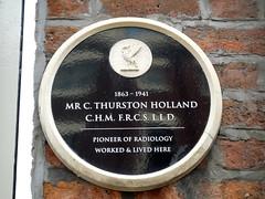 Photo of C. Thurston Holland black plaque