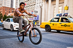 Free wheelie (sjmgarnier) Tags: road street newyorkcity people urban usa newyork man cars bike wheel bmx freestyle manhattan cab taxi september biker portfolio unionsquare youngman wheelie bmxbike 2011 frontwheel unionsquareeast backwheel colorstreetphotography streetbmx