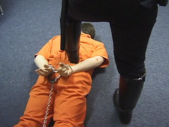Cop Domination 8 (TBTAOTW2011) Tags: cop police uniform leather black boots bootlick boot worship lick prisoner abuse domination humiliation academy men dominant shine polish