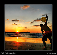 Frisbee (polis poliviou) Tags: city sunset sea lighthouse seascape man beach canon coast israel telaviv seaside sand middleeast cyprus september frisbee romantic seaview polis herzliya cypriot shootingstar flyingdisc hertzliya brilliantphoto telavivdistrict colorphotoaward totallyunique flickroid perfectphotographeraward arenabeach discshaped superaward flickraward poliviou polispoliviou  herliya