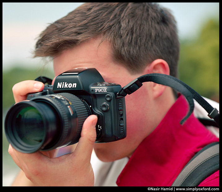 Photographer using a Nikon F90X camera