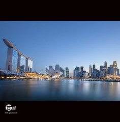 46th Singapore (Tomatoskin) Tags: sea moon reflection sunrise pov resort bluehour kam casinos stb structure floating helixbridge esplanadedrive sigma10mm20mm singaporeflyer marinabaysands singaporetourismboard canoneos40d tomatoskin locationsingapore integratedresortir singaporeaneuphemism uniquelysingapore2010 bluehoursingapore gettyimagessingaporeq1 gettyimagessingaporeq2