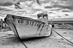 waiting for the tide (iFovea) Tags: sea sky france beach monochrome clouds boats nik ido oleron silverefex
