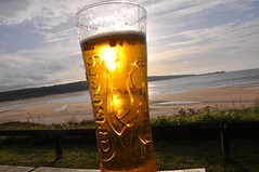 (manicuredcorpse) Tags: ocean sea england beach beer cornwall pint stives carlsberg hayle stivesbay heyl porthia thebluffinn