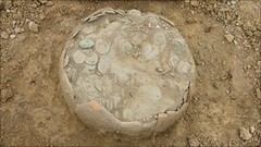 ceramic pot of coins