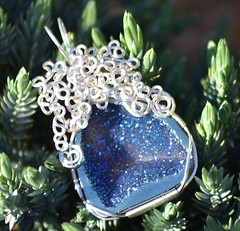 Titanium druzy cab with Sterling silver wire. (Axolotl Glitterati) Tags: wrapping wire hand handmade gothic made horror medusa wirewrapping artisanjewelry uniquejewelry oneofakindjewelry