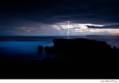 Lightning - explore (john white photos) Tags: ocean sea cliff storm evening power australian australia strike lightning electrical southaustralia darkclouds streakybay eyrepeninsula