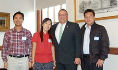 Gov. Paul LePage poses with three Chinese guest teachers.