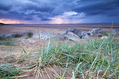 Blue Grass (Jo_Krazy) Tags: sunset sea sky beach grass rain clouds sand rocks tripod newbrighton sigmalens1020mm ndgradfilter canon60d