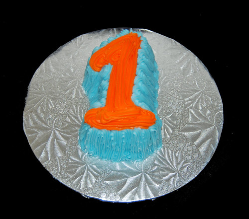blue and orange 1 shaped smash cake