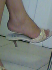 Candid teen flipflop shoeplay dangling feet 3