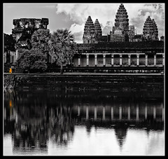 reflecting monk and the majestic temple (explored) (PNike (Prashanth Naik)) Tags: sky bw orange reflection building water architecture temple blackwhite nikon asia cambodia angkorwat monks sacred siemreap selectivecoloring d7000 pnike